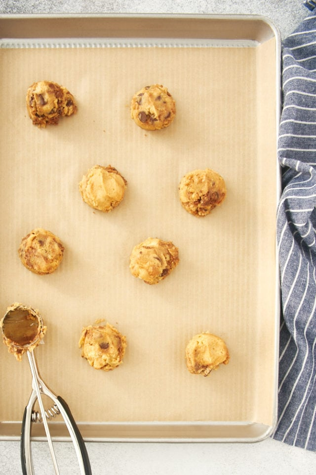 overhead view of Nutella Peanut Butter Cookie dough on a parchment-lined baking sheet