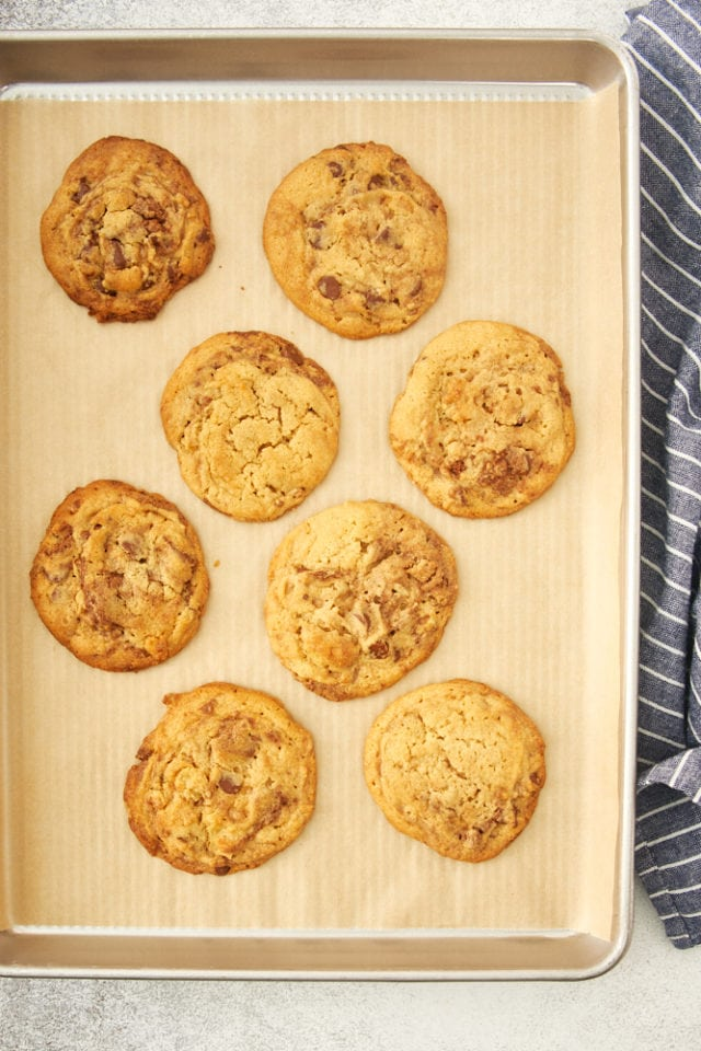 baked Loaded Nutella Peanut Butter Cookies on a parchment-lined baking sheet