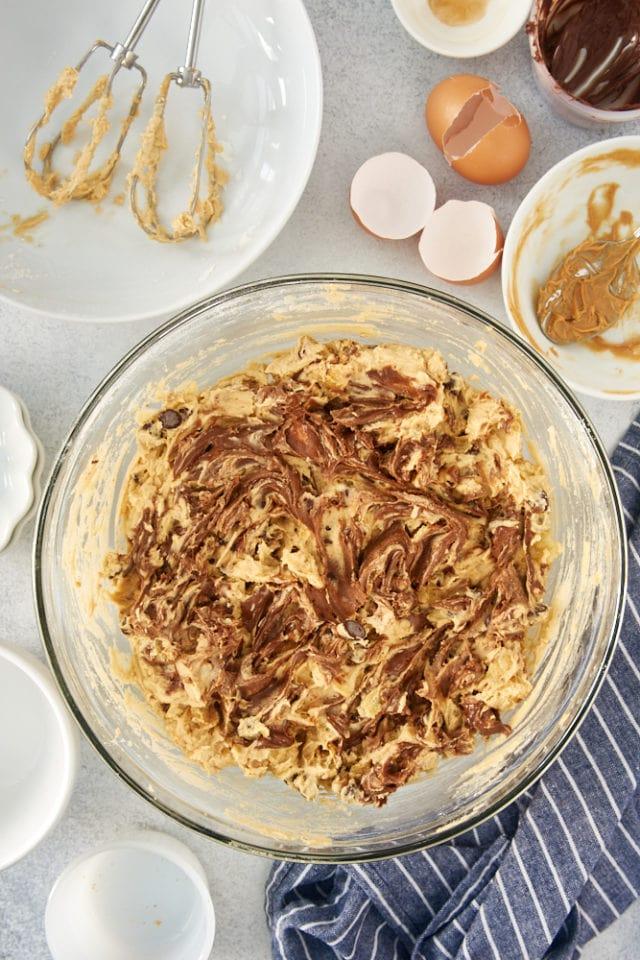 peanut butter cookie dough with chocolate-hazelnut spread swirled into it