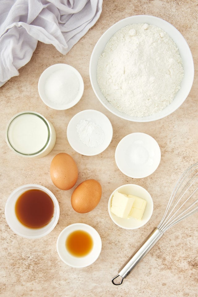 ingredients for Pancake Muffins, including flour, sugar, eggs, and maple syrup