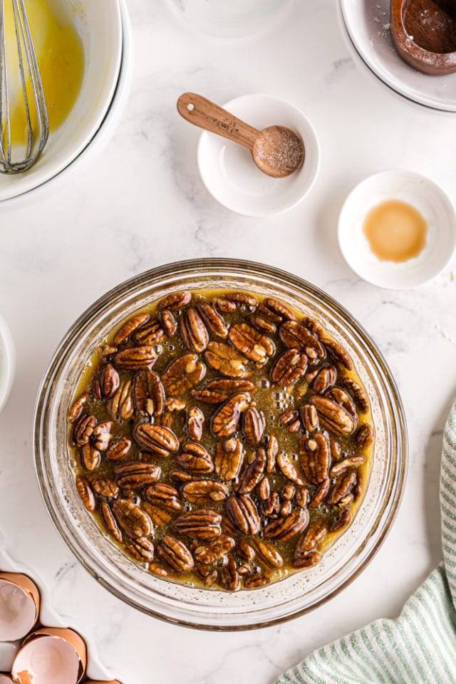 overhead view of pecan pie filling in a glass mixing bowl