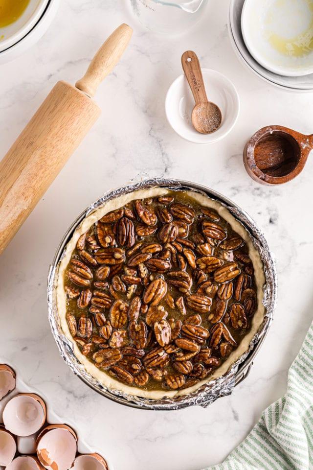overhead view of unbaked Deep-Dish Pecan Pie in a springform pan