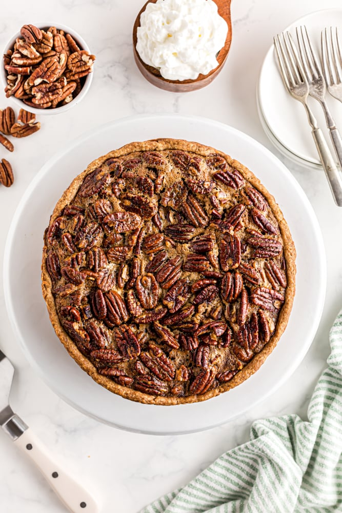 overhead view of Deep-Dish Pecan Pie on a white pedestal