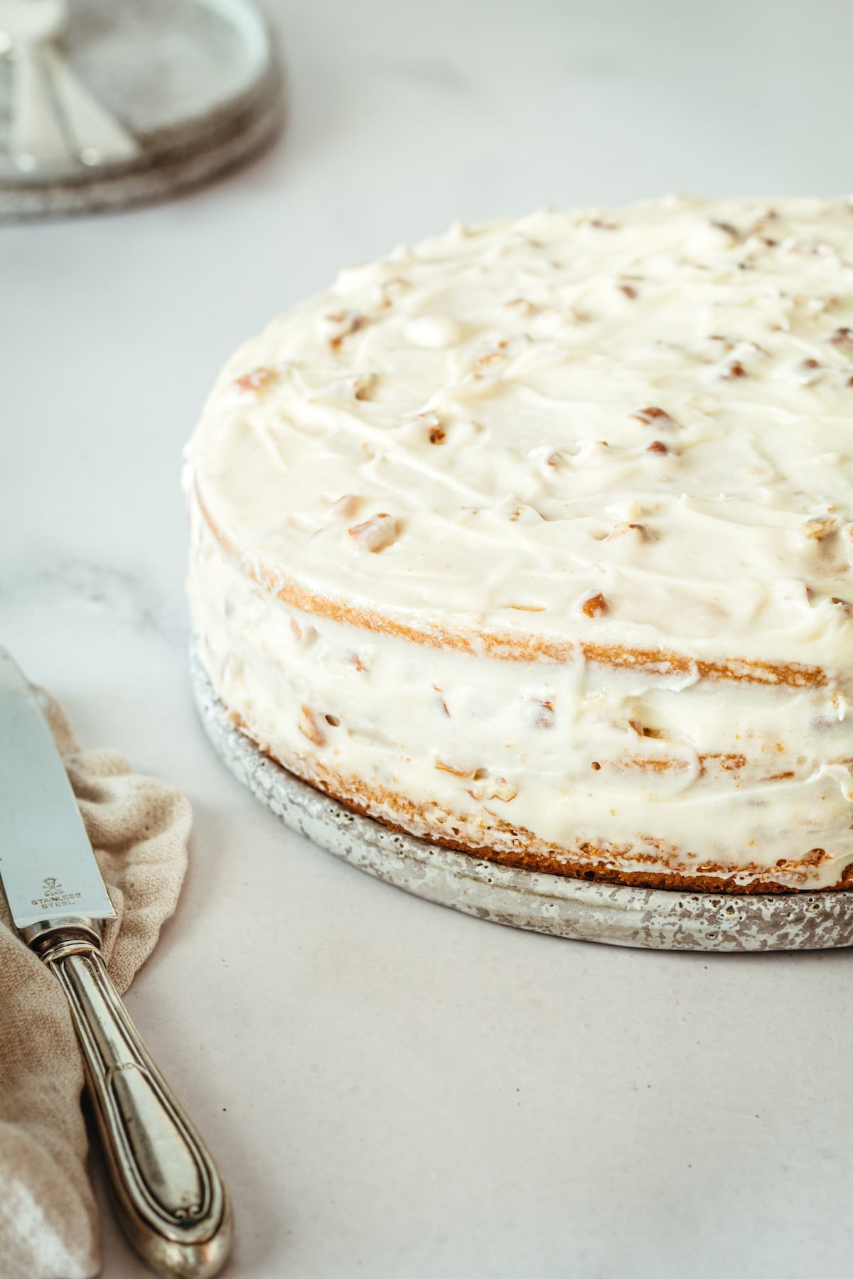 Whole Italian Cream Cake on cake plate after frosting
