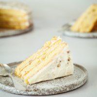 Slice of Italian Cream Cake on plate with spoon