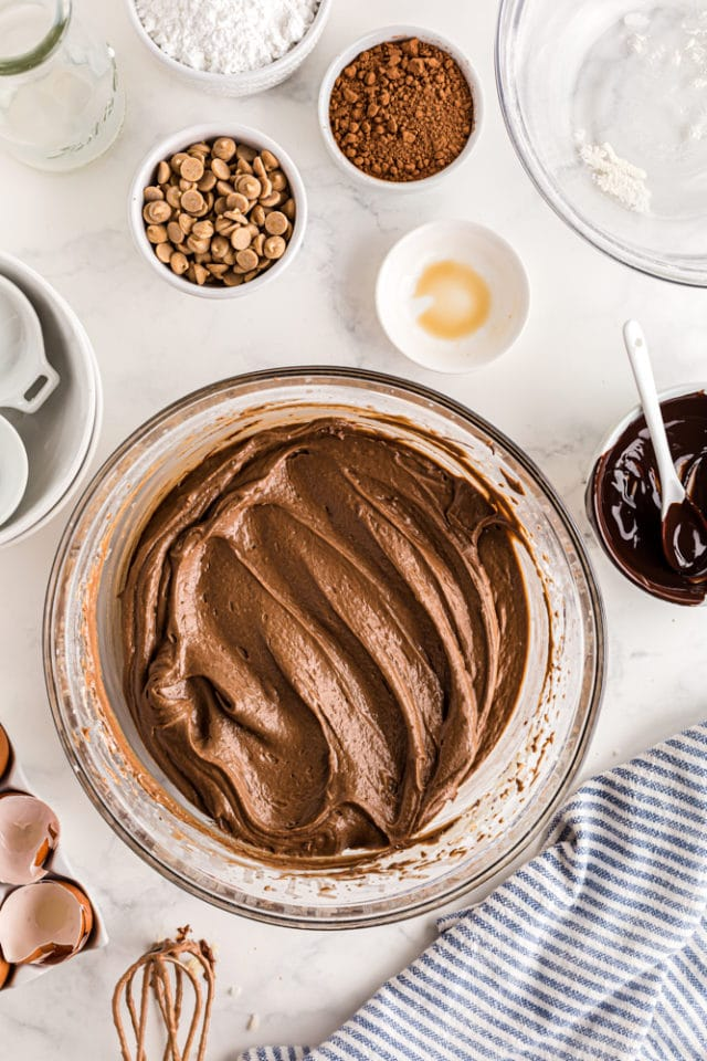 overhead view of chocolate cake batter in a glass mixing bowl