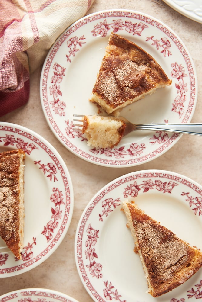 slices of Cinnamon Pear Cake on red floral-rimmed white plates