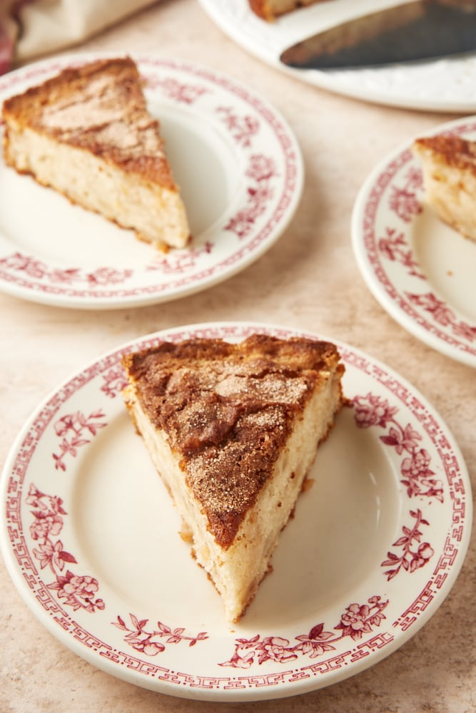 pear cake slices on floral-rimmed white plates