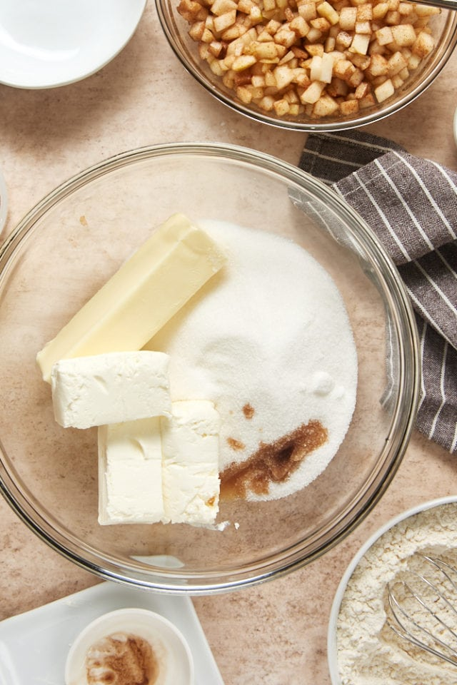 butter, sugar, cream cheese, and vanilla extract in a glass mixing bowl